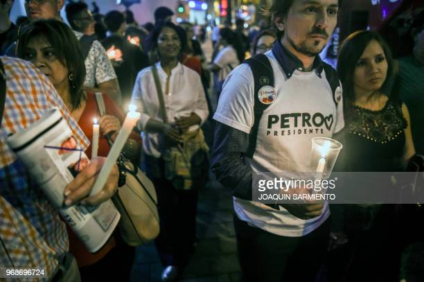 Supporters of Colombia's presidential candidate for the Colombia Humana Party, Gustavo Pero, take part in a campaign rally in Medellin, Colombia on...