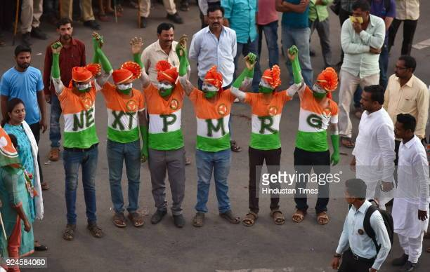 Supporters of Congress during Janashirvad Yatra of Congress President Rahul Gandhi at Chennamma Circle on February 26 2018 in Hubballi India This is...