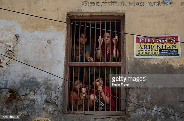 Supporters of Congress Party's Rahul Gandhi wait for his convoy to pass on May 10 2014 in Varanasi India India is in the midst of a ninephase...