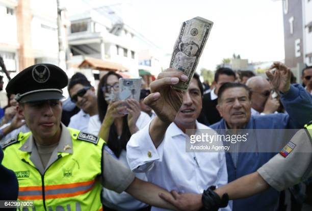 Supporters of Conservative party candidate Guillermo Lasso cheer up in Quito on February 19 2017 Exit polls in Ecuador's presidential election...