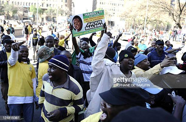 Supporters of controversial African National Congress youth leader Julius Malema demonstrate on August 30 2011 in Johannesburg ahead of his...