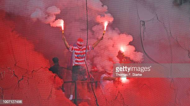 Supporters of Cottbus fire smoke bombs during the 3. Liga match between FC Energie Cottbus and F.C. Hansa Rostock at Stadion der Freundschaft on July...
