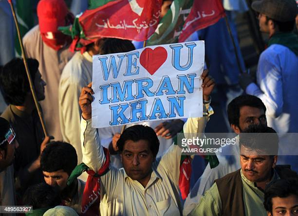 Supporters of cricketer-turned politician and chairman of Pakistan Tehreek-e-Insaf or Movement for Justice party, Imran Khan , attend an...