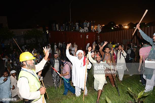 Supporters of cricketerturnedpolitician Imran Khan and Canadian cleric Tahir ul Qadri march towards prime minister house in Islamabad on August 30...