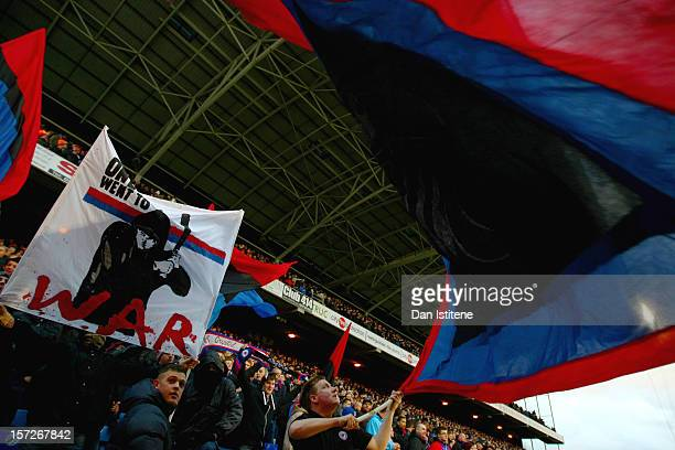 Supporters of Crystal Palace waves flags and hold banners aloft before the npower Championship match between Crystal Palace and Brighton Hove Albion...