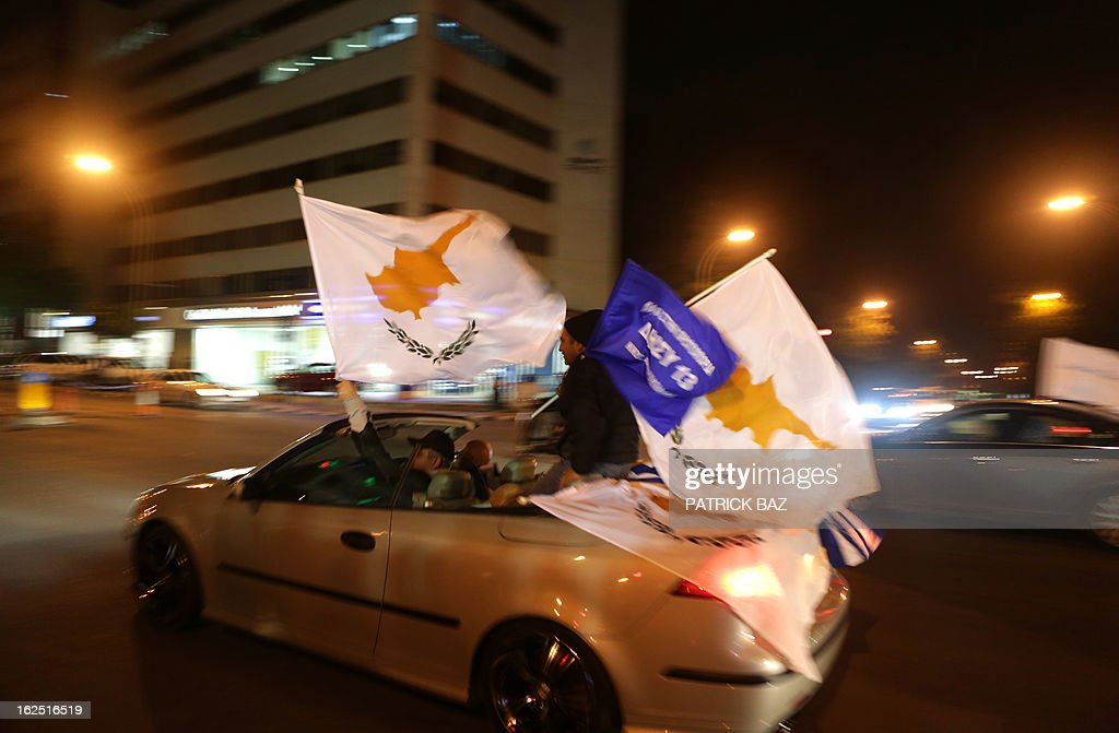 Supporters of Cypriot right-wing leader Nicos Anastasiades holding Cypriot flags drive through a street in Nicosia as they celebrate that he won the presidential election on February 24, 2013. Anastasiades won the presidential election in Cyprus, securing a mandate to negotiate a crucial bailout for the EU state on the brink of bankruptcy.