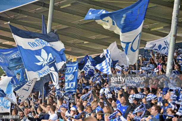 Supporters of Darmstadt cheer their team during the Second Bundesliga match between SV Darmstadt 98 and DSC Arminia Bielefeld at MerckStadion am...