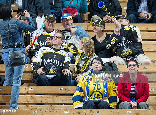 Supporters of Davos and Rouen celebrate during the Champions Hockey League match between HC Davos and Rouen Dragons at Vaillant Arena on August 19...