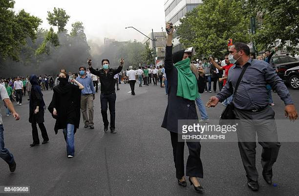 Supporters of defeated Iranian presidential candidate Mir Hossein Mousavi shout slogans as they protest the elctions results in Tehran on June 13...