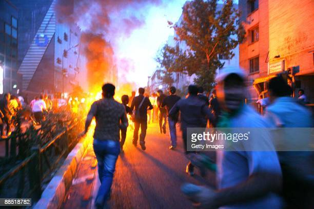 Supporters of defeated Iranian presidential candidate Mir Hossein Mousavi run in the streets during protests June 16, 2009 in Tehran, Iran. Iran...