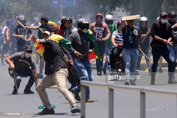 Supporters of defeated presidential candidate Carlos Mesa clash with those of Bolivian President Evo Morales over contested election results which...