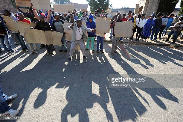 Supporters of defendants Chris Mahlangu and Patrick Ndlovu outside the Ventersdorp magistrates court on May 22 2012 in Ventersdorp South Africa The...