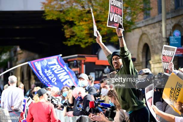 Supporters of Democratic candidate Joe Biden and Republican candidate Donald Trump face each other as hundreds gather outside the central ballot...