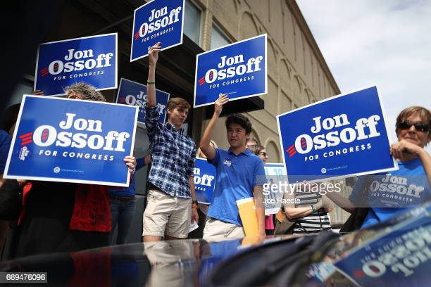 Supporters of Democratic candidate Jon Ossoff hold campaign signs as he runs for Georgia's 6th Congressional District in a special election to...