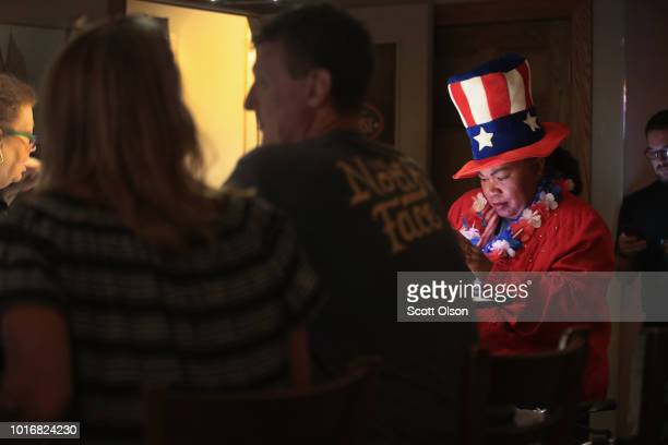 Supporters of Democratic congressional candidate Randy Bryce wait for returns to come in at an electionnight rally on August 14 2018 in Racine...