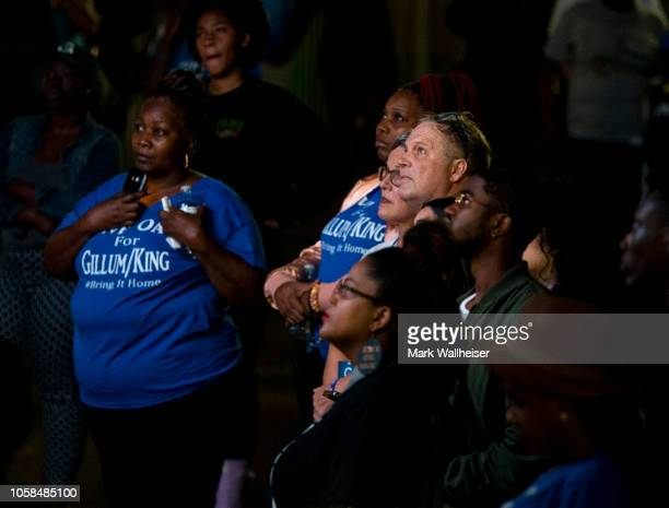 Supporters of Democratic gubernatorial candidate Andrew Gillum listen to his concession speech November 6 2018 in Tallahassee Florida Gillum fell...