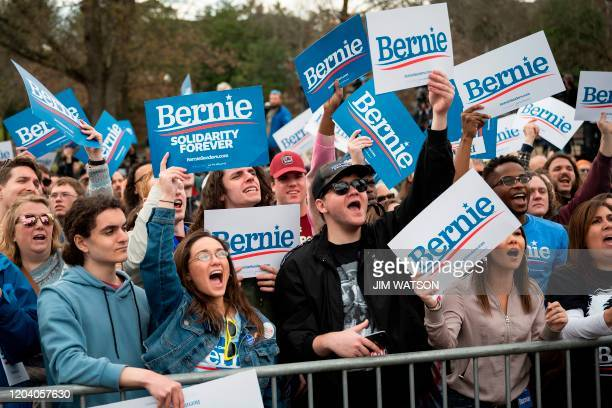 Supporters of Democratic party White House hopeful Bernie Sanders cheer during a rally in Columbia SC on February 28 2020 Sanders is battling...