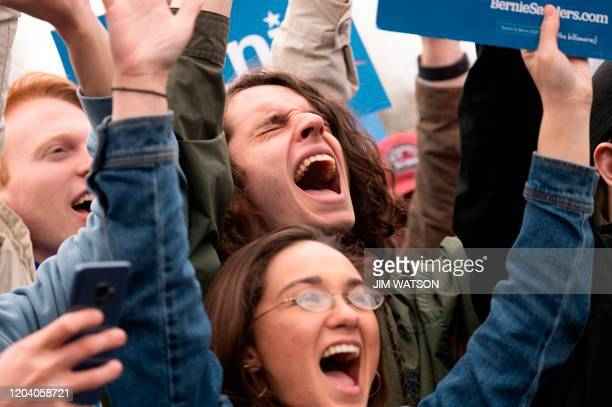 Supporters of Democratic party White House hopeful Vermont Senator Bernie Sanders cheers during his speech at a rally in Columbia South Carolina on...