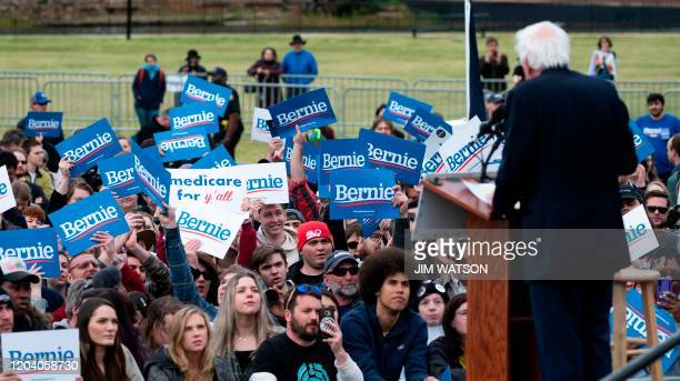 Supporters of Democratic party White House hopeful Vermont Senator Bernie Sanders listen while he speaks at a rally in Columbia South Carolina on...