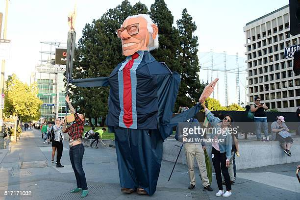 Supporters of Democratic presidental candidate Sen Bernie Sanders gather before his rally at The Wiltern Theatre on March 23 2016 in Los Angeles...