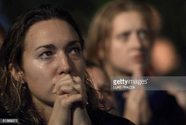 Supporters of Democratic presidential candidate and US Vice President Al Gore watch a big screen television report describing the extremely close...
