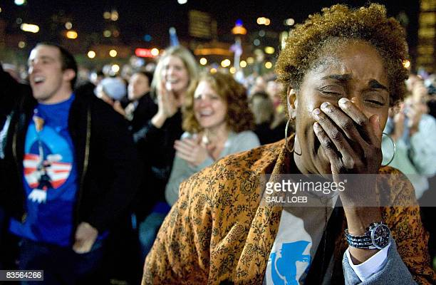 Supporters of Democratic presidential candidate Barack Obama react to news that CNN projects him to be the winner of the election while waiting for...