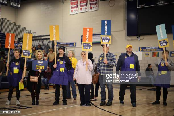 Supporters of Democratic presidential candidate Democratic presidential candidate former South Bend Indiana Mayor Pete Buttigieg prepare to caucus...