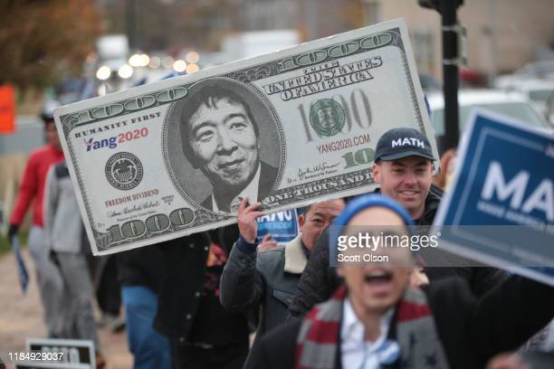 Supporters of Democratic presidential candidate entrepreneur Andrew Yang march outside of the Wells Fargo Arena before the start of the Liberty and...