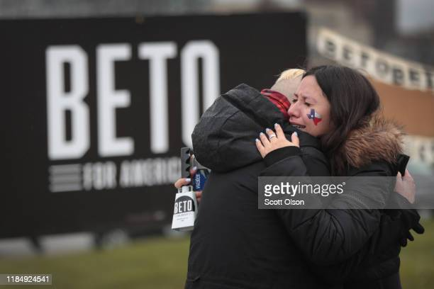 Supporters of Democratic presidential candidate former Rep Beto O'Rourke embrace after learning he was dropping out of the presidential race before...
