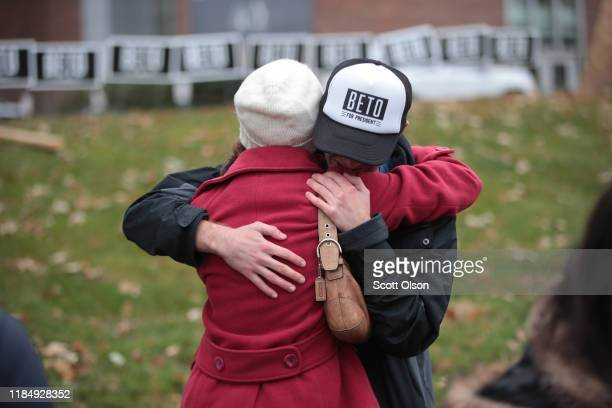 Supporters of Democratic presidential candidate former Rep Beto O'Rourke embrace after learning he was dropping from the presidential race before the...