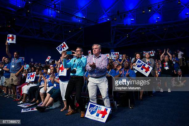 Supporters of Democratic Presidential candidate Hillary Clinton cheer during a speech at the Minneapolis Convention Center on July 18 2016 in...