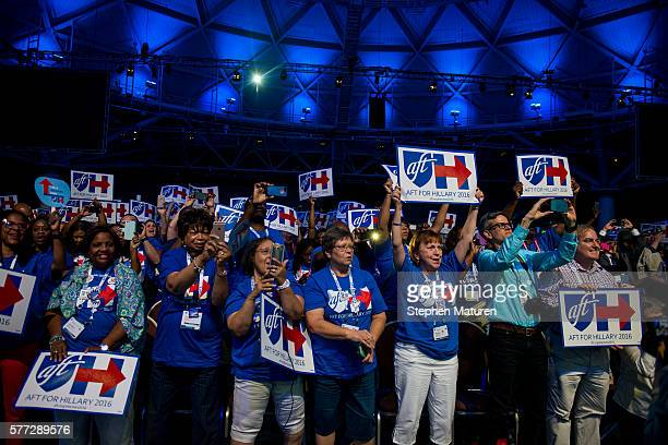 Supporters of Democratic Presidential candidate Hillary Clinton cheer as she walks on stage at the Minneapolis Convention Center on July 18 2016 in...