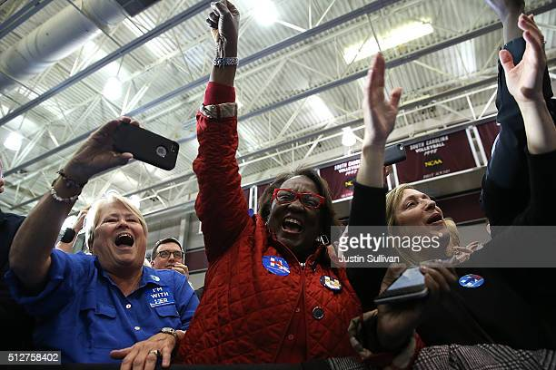 Supporters of Democratic presidential candidate Hillary Clinton celebrate during her primary night gathering at the University of South Carolina on...