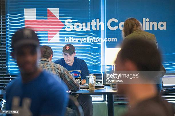 Supporters of Democratic presidential candidate Hillary Clinton make phone calls from a campaign field office to encourage voters in South Carolina...