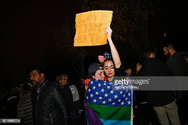 TOPSHOT Supporters of Democratic presidential candidate Hillary Clinton react outside the White House early November 9 2016 in Washington DC Trump...
