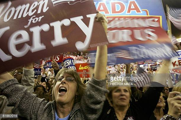 Supporters of Democratic Presidential Candidate John Kerry greet him at the University of Nevada in Reno Nevada 23 October 2004 AFP PHOTO / HECTOR...