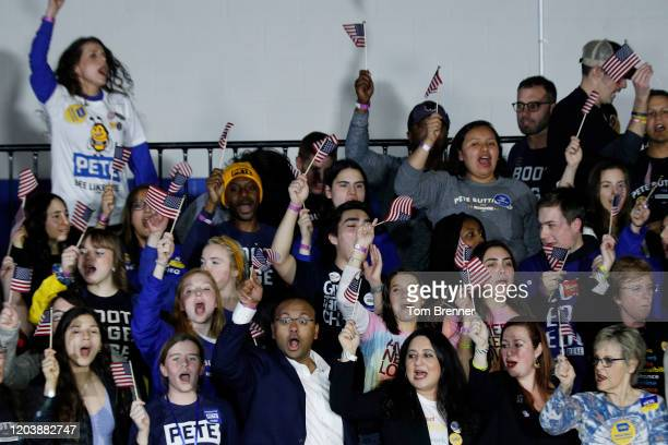 Supporters of democratic presidential candidate Pete Buttigieg cheer at his caucus night watch party on February 03 2020 in Des Moines Iowa Iowa is...