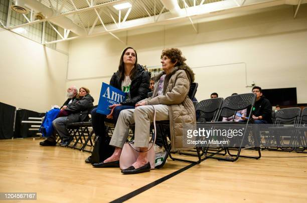 Supporters of Democratic presidential candidate Sen Amy Klobuchar sit and wait after her rally was cancelled after being disrupted by protestors on...