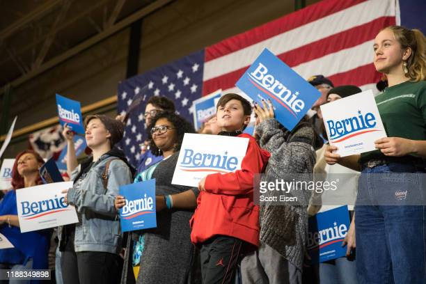Supporters of Democratic presidential candidate Sen Bernie Sanders hold up signs during his event at Nashua Community College on December 13 2019 in...