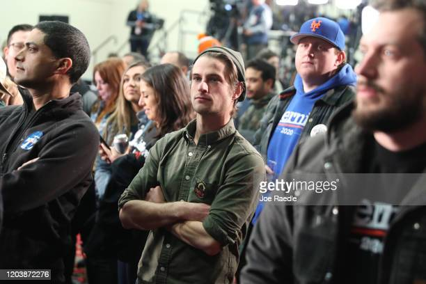 Supporters of democratic presidential candidate Sen. Bernie Sanders attend his caucus night watch party on February 03, 2020 in Des Moines, Iowa....