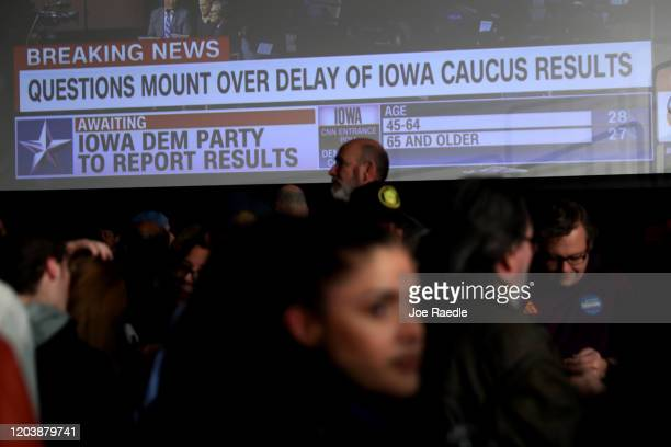 Supporters of democratic presidential candidate Sen Bernie Sanders wait for results to come in at his caucus night watch party on February 03 2020 in...