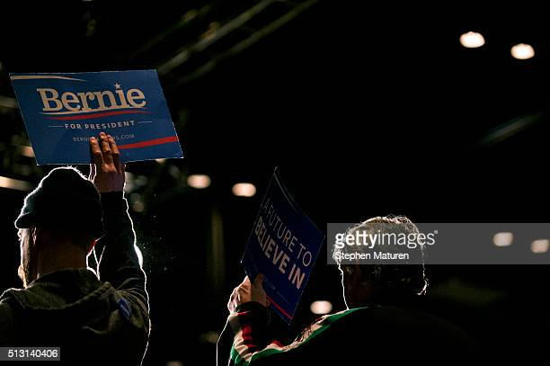 Supporters of Democratic presidential candidate Sen Bernie Sanders hold sings in support during his speech at the Minneapolis Convention Center...