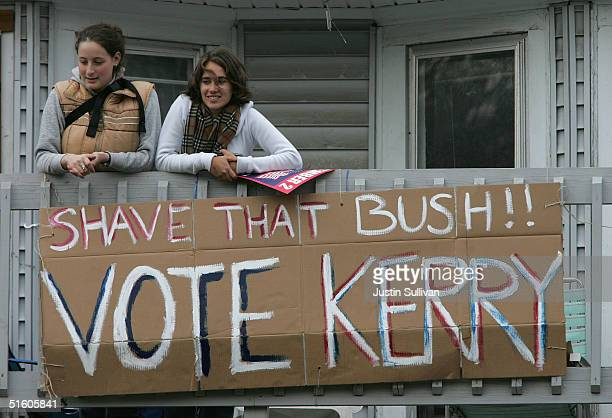 Supporters of Democratic presidential candidate US Senator John Kerry hold a sign off of their balcony during a rally on the steps of the State...