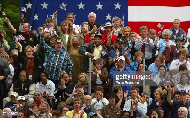 Supporters of Democratic presidential candidate US Senator John Kerry cheer while the Senator is speaking during a ceremony to commemorate the 50th...