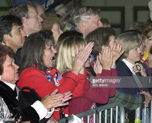 Supporters of Democratic presidential candidate US Vice President Al Gore clap as election results roll in at the War Memorial Plaza in downtown...