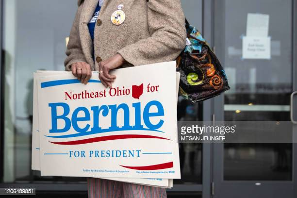 TOPSHOT Supporters of Democratic presidential candidate Vermont Senator Bernie Sanders leave Huntington Center in Cleveland Ohio after the rally was...