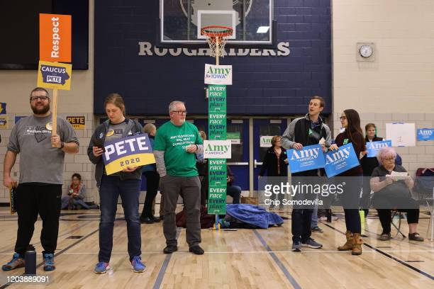 Supporters of Democratic presidential candidates former South Bend Indiana Mayor Pete Buttigieg and Sen Amy Klobuchar prepare to caucus for them in...