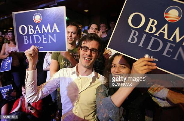 Supporters of Democratic presidential hopeful Barack Obama wave cardboards on Election Night in Amsterdam on November 4 2008 Supporters gathered to...