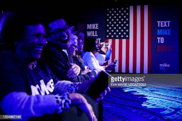 Supporters of Democratic presidential hopeful former New York mayor Mike Bloomberg attend a rally at Palm Beach County Convention Center in West Palm...