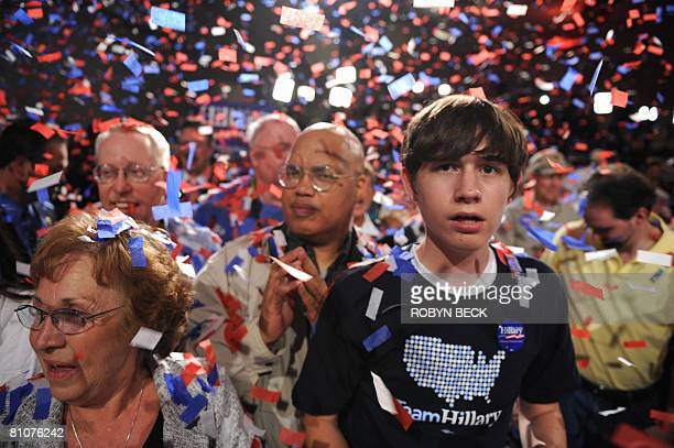 Supporters of Democratic presidential hopeful New York Senator Hillary Rodham Clinton attend Clinton's primary election night celebration at the...